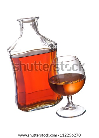 Wineglass and bottle with cognac. Abstract drink composition - stock photo