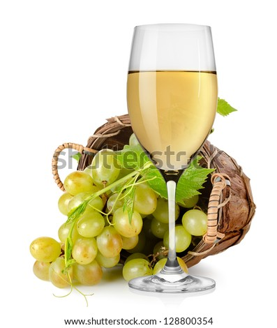 Wineglass and  grapes in a wooden basket isolated - stock photo