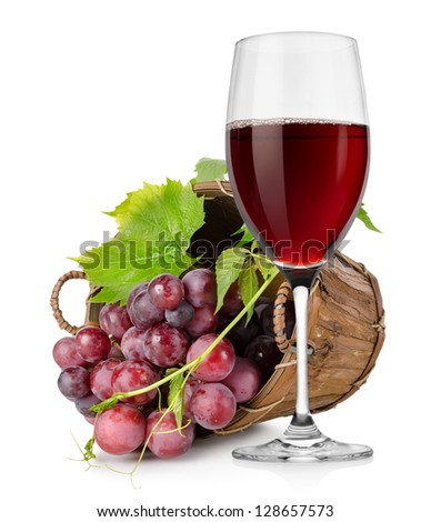 Wineglass and  grapes in a wooden basket isolated on white background
