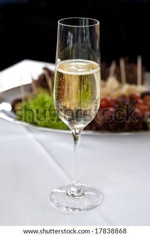 Wineglass of champagne on the table - stock photo