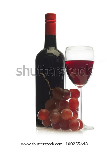 Wineglass of red wine and a bottle with grape isolated over white