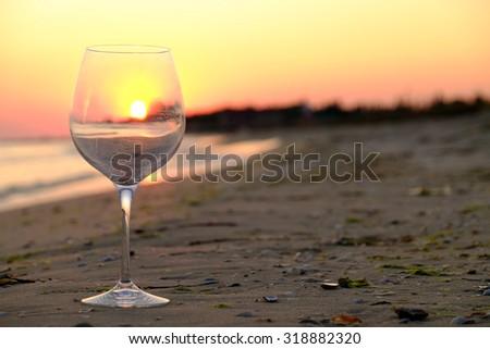 Wineglass on the seashore - stock photo