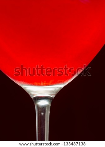 Wineglass with cold red wine - stock photo