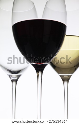 Wineglass with red  and white wine on a white background - stock photo