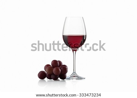 Wineglass, with red  wine and red grapes isolated on white background - stock photo
