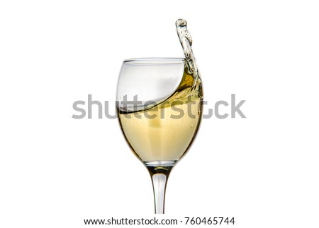 Wineglass with splashing drops of champagne - motion freeze close-up picture isolated on the white background.