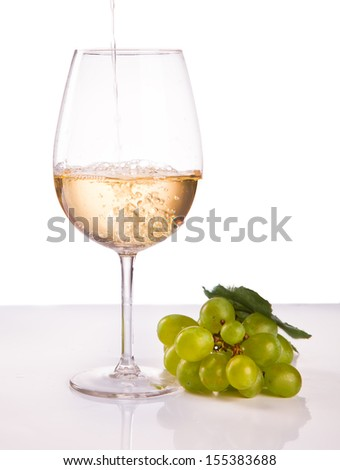 wineglass with white wine and grape isolated on white background - stock photo