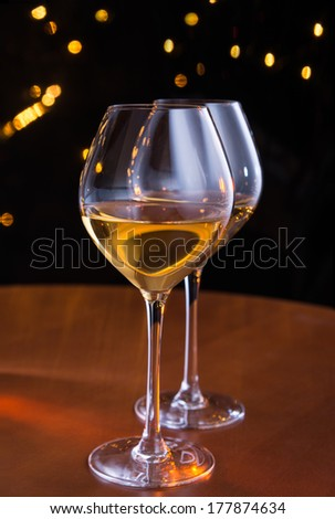 Wineglasses in bar - stock photo