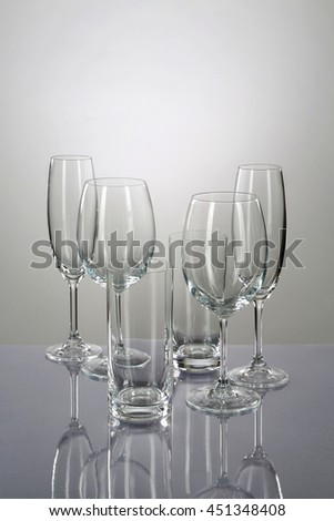 Wineglasses on a mirror table - stock photo
