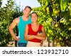 Winegrower, Woman and man standing at vineyard and smiling in the sunshine - stock photo