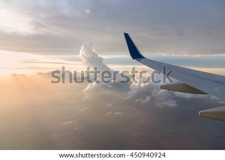 Wing aircraft at cloud sunset view from plane