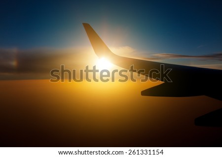 Wing aircraft at sunset - stock photo