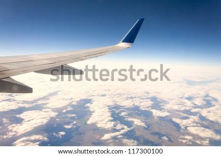 Wing aircraft in altitude during flight - stock photo