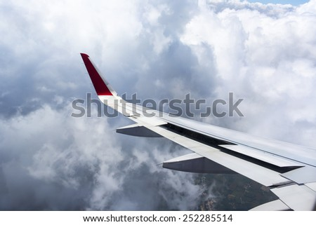 Wing aircraft in the storm sky  - stock photo