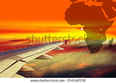 Wing airplane on Africa map background. - stock photo