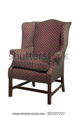 Wing arm chair shapely in design red upholstered English antique isolated on white with clipping path