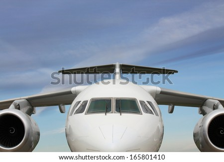 Wing, fuselage and  turbine of the passenger jet  - stock photo