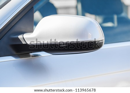 Wing mirror on a silver car - stock photo