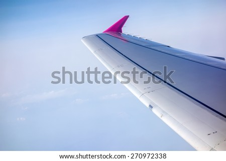 Wing of airplane flying