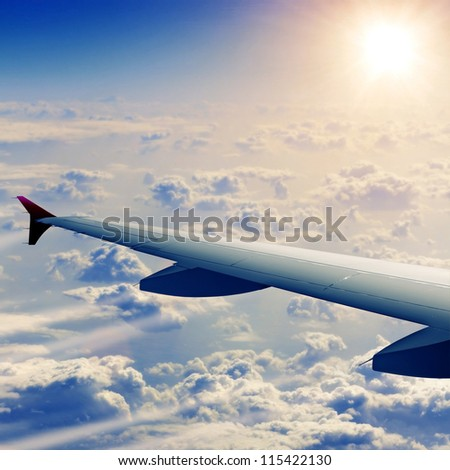 Wing of airplane from window - stock photo