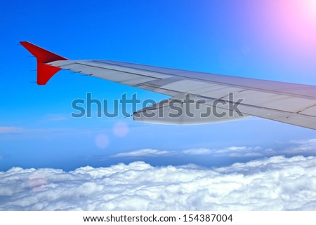 Wing of airplane on the cloud