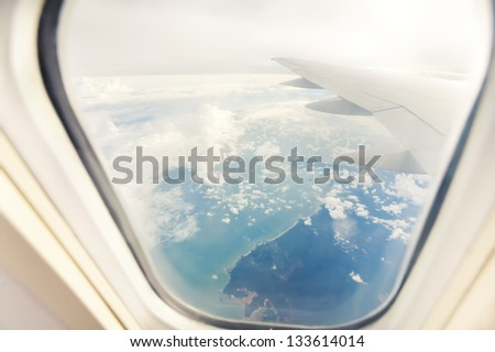 wing of airplane - view through the window - stock photo