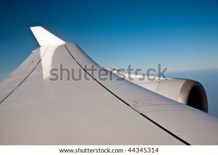 wing of an aircraft in the blue clear sky