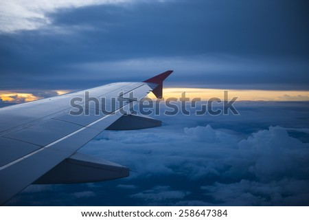Wing of an airplane in the sunset. - stock photo