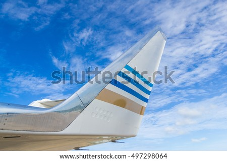 Wing of big airplane on beautiful blue sky background, fast aerial transport, traveling and voyage concept.