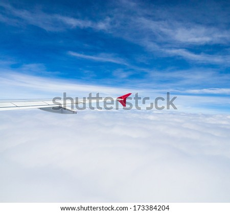Wing over Lands Cloudscape Around  - stock photo