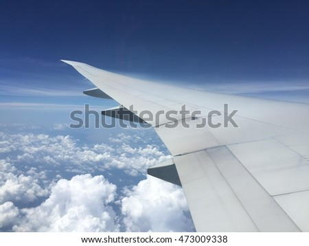 Wing plane and beautiful clouds background