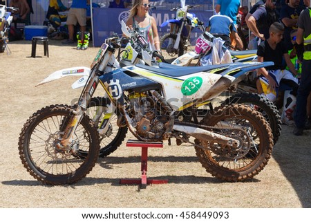 Wingate, Israel - July 23, 2016: Husqvarna Motocross bike on a racing stand at Husqvarna's service spot before the race starts.
