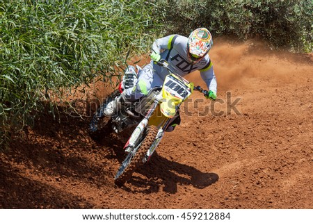 Wingate, Israel - July 23, 2016: Motocross rider take on a tight but fast turn during the final heat of the race.