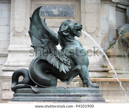 Winged dragon, St. Michel fountain, Paris - stock photo