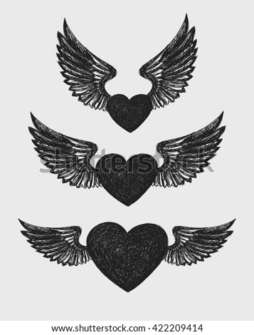 Winged Heart. A set of three hearts with wings. - stock photo
