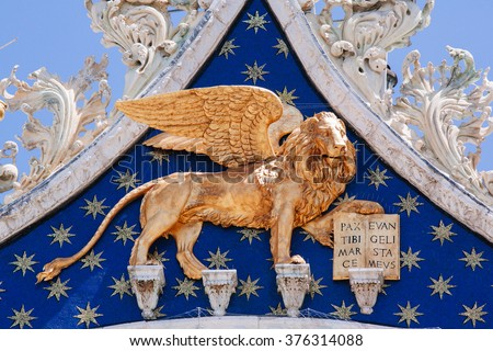 Winged Lion, symbol of Venice, on the facade of St. Mark Cathedral. Venice, Italy - stock photo