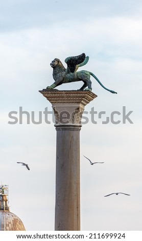 Winged St Mark Lion symbol of Venice on its column - Venice, Italy - stock photo