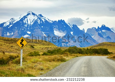 Winging road sign in the national park Torres del Paine, Patagonia, Chile, South America  - stock photo