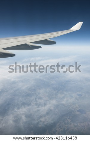 wings in sky - stock photo
