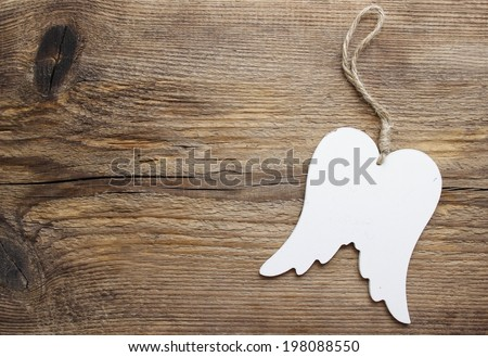 Wings of angel on wooden background, copy space - stock photo