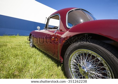 WINGS & WHEELS  CALGARY CANADA 21 6 2015:Father's Day Weekend where some vintage Cars and Aircrafts on display. A Burgundy MG on display. - stock photo