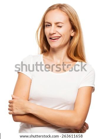 Winking woman. Hamming happy female isolated on white - stock photo