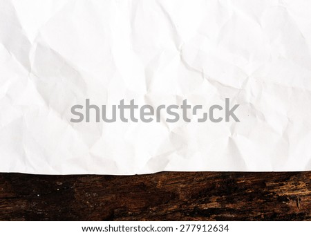Winkle ripped off paper from notebook page on background - stock photo