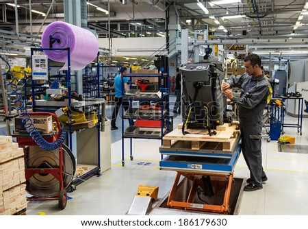 "WINNENDEN, GERMANY - MARCH 01, 2014:  Machine-building plant of the company Karcher ""Alfred Karcher GmbH & Co. KG"". Assembly cleaning machines - stock photo"