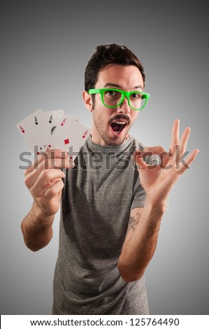 winner guy holding poker cards on grey background