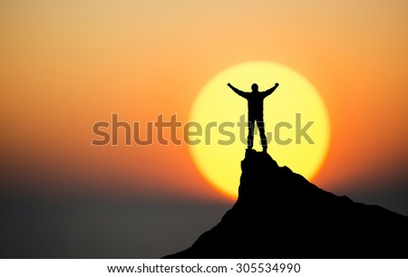 Winner on the mountain top. Sport and active life concept