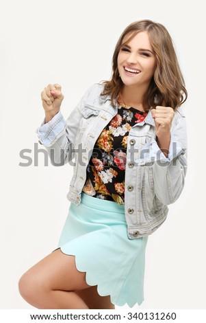 Winner.Portrait of laughing girl gesturing. - stock photo