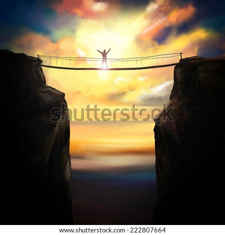 Winner silhouette on a bridge between two rock tops at sunset. - stock photo