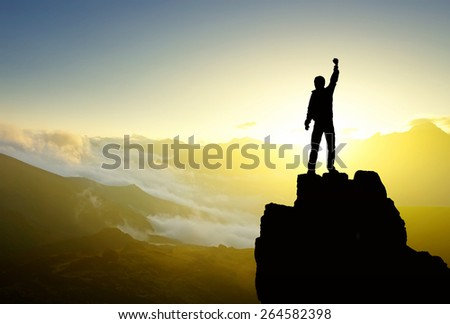 Winner silhouette on mountain top. Sport and active life concept