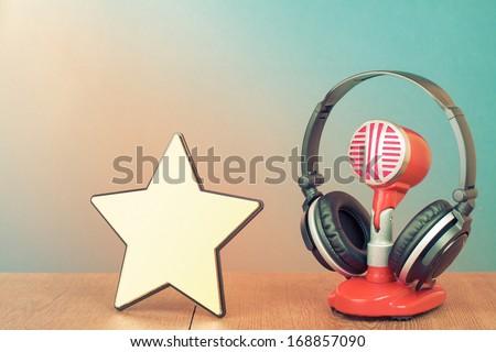 Winner star blank, retro microphone, headphones - stock photo